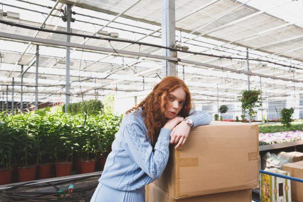 girl-lying-on-boxes-in-orangery-PG3CMM6
